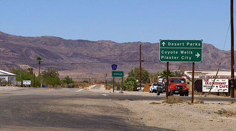 Photo of the Imperial Highway, County Road S-2, looking north through Ocotillo, California, with the Coyote Moutains in the distance